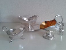 Two silver plated sauce bowls and a silver plated sugar jar in the shape of a scuttle