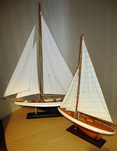 Two model sailing yachts