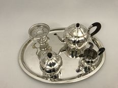 Silver four piece tea set with silver chafing dish on ivory feet, Netherlands and Koch & Bergfeld, Germany