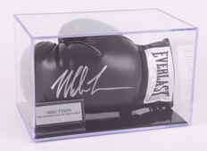 Boxing Glove. Hand-signed with silver pen by Mike Tyson in a display case