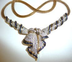 18 kt / 750 gold necklace for parties with approx. 4 ct. Gemstone sapphires and diamonds