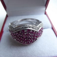 Silver ring with many rubies.