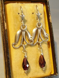 Earrings with faceted garnet drops