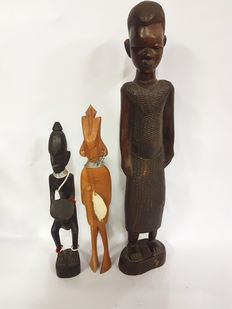 Sculptures of shamans and African youngster