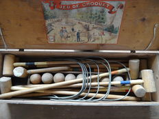 Old croquet game in wooden box