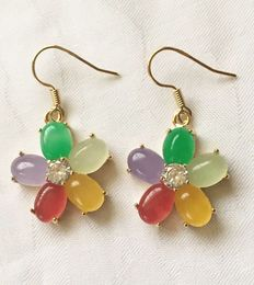 Gold floral earrings with various gemstones; emerald, aventurine, lilac jade, carnelian, calcite and zircon