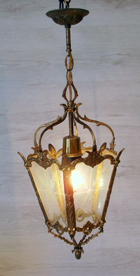 Brass hanging lamp with decorated glass.