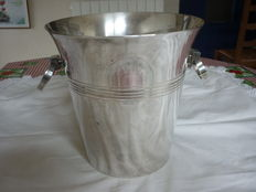Silver plated metal champagne bucket, with handles forming a crescent shape