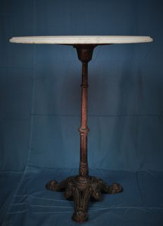 Nostalgic heavy wrought iron table with marble top, France, first half 20th century