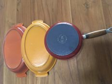 Le Creuset casserole and two cast iron enamelled oven pans