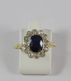 Bicolour gold entourage ring, set with diamonds and sapphires.