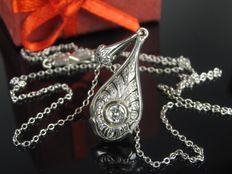 A 14 kt gold necklace with 0.12 ct diamond pendant necklaceG