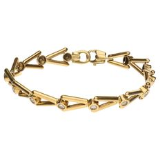 Yellow gold fantasy link bracelet set with 13 brilliant cut diamonds of 0.03 ct. 0.39 ct in total