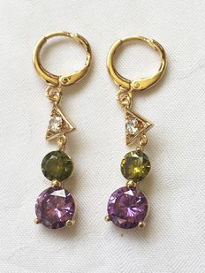 Gold earrings with coloured crystals.