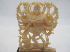 Ivory statue on a wooden base of a dancing Shiva - India - ca. 1930.