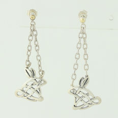 Earrings in solid silver 925/1000 and 18 kt gold (750/1000) with diamonds.