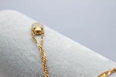 14K + 18k yellow gold pendant and necklace inlaid with diamonds