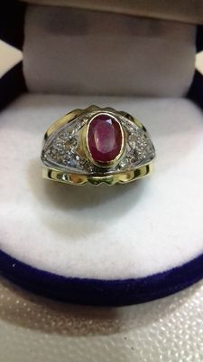 Gold women's ring with ruby and diamonds.
