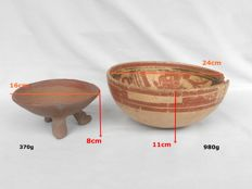 Pre-Columbian two bowls, one larger and one smaller one, standing on 3 face shaped feet (2)