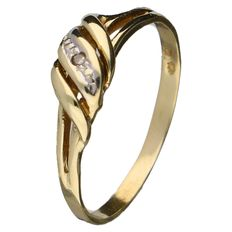 Yellow gold ring set with a 0.01 ct brilliant cut diamond