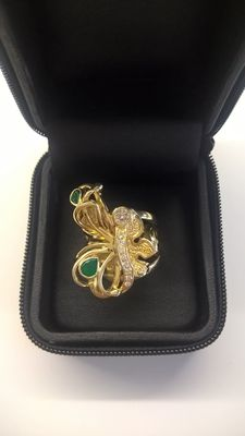 Gold ring with 9 diamonds, 0.65 ct, and 2 emeralds, 1.75 ct.