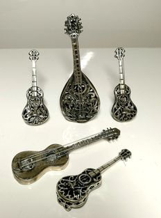 Lot of five miniature musical instruments in silver