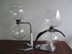 Two glasses from coffee machines Hellem and Cona
