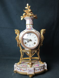 Porcelain clock with gold plated ornaments - 2nd half 20th century