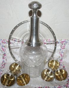 Rare old liqueur service, cut crystal decanter with sterling silver mount and cut crystal with sterling silver mount  coaster, 6 sterling silver cups with Minerve 1st title punches (950/1000), 19th century