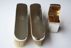 Two brushes with silver back and silver box, William Hutton & Sons and C. Sanders & F. Shepard, Birmingham and Chester, 1909 and 1903