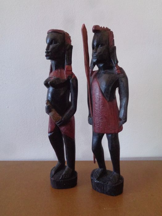 Maasai warrior and woman carved in wood