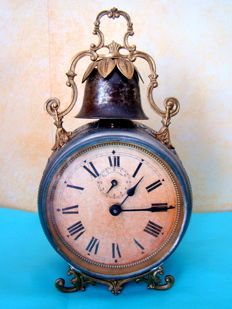 Antique alarm clock with the initials D.F. and the inscription 'réveil per CTIONNE'