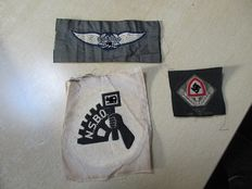 Three German fabric emblems from World War II.