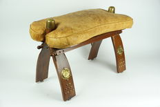 Beautiful vintage oak camel saddle with leather seat and copper ironwork.