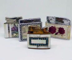 Collection of petrol lighters in chromed metal and mother of pearl lined in different motifs - mid 20th century