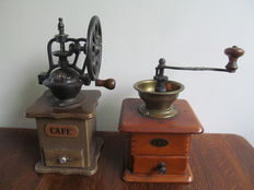 Two old wooden coffee grinders with copper and cast iron top