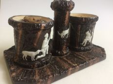 Ink set from ceramics with hunting scene.