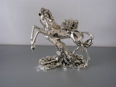 silver sculpture horse, mustang with jaguar