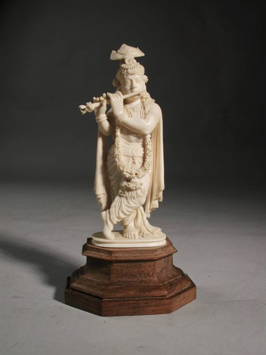 A finely carved ivory Krishna on original base - India - ca 1900-1920