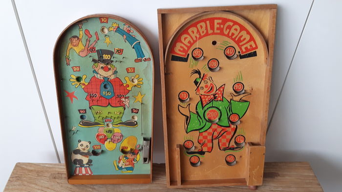 Two antique pinball machines/marble games.