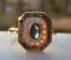 Octagonal-shaped ring in 18 kt yellow gold with blue sapphires and small diamonds