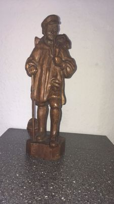 Wood Carving of Man with Rucksack and Pipe