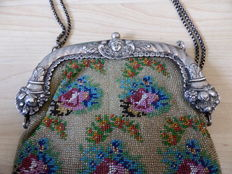 Silver bag with bracket and beads