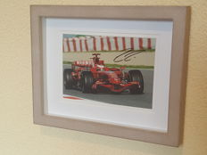 Kimi Raikkonen - World champion F1 - original autographed framed photo Ferrari + COA.