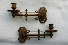 A pair of gilded metal piano candelabra, first half of the 20th century