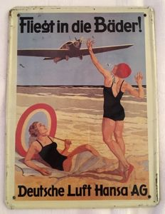 "Old enamel sign ""LUFTHANSA fliegt in die Bäder!"""