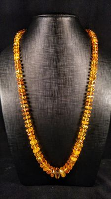 Long genuine Baltic Amber lemon colour faceted necklace, 55 grams