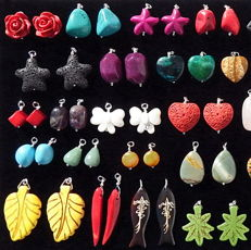 Assortment of 94 mineral paired pendantds set in silver 925