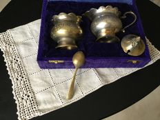 Circa 1910, France, set of antique milk jug, sugar bowl and pot, including 1 sugar spoon in Louis XVI style.  They come in the original box, which is built in yellow silk and velvet.  Circa 1910