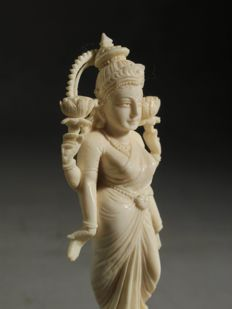 A fine carved ivory Lakshmi, on original base - India - ca. 1900-1920